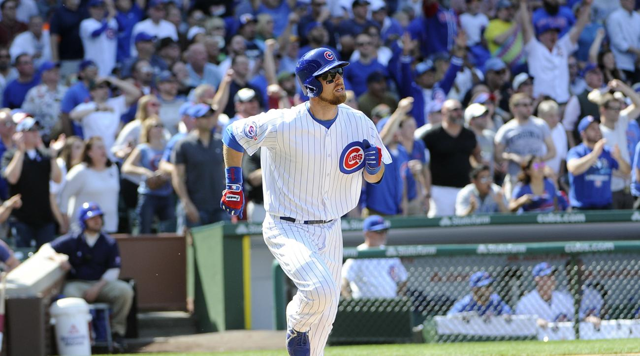 Chicago Cubs' Ben Zobrist runs the bases after hitting a three-run home run against the Washington Nationals during the fifth inning of a baseball game, Friday, May 6, 2016, in Chicago. (AP Photo/David Banks)