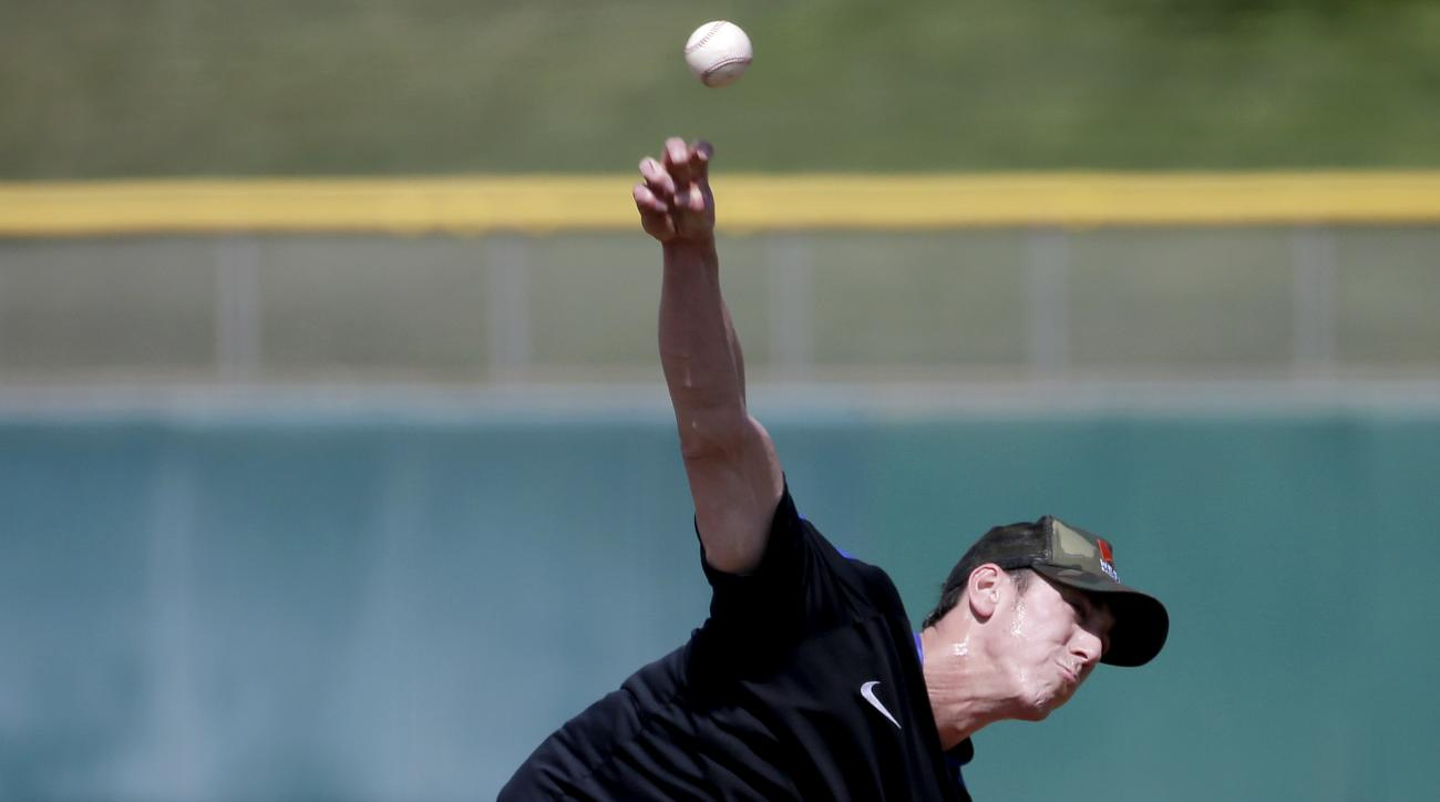 Pitcher Tim Lincecum throws for MLB baseball scouts, Friday, May 6, 2016, at Scottsdale Stadium in Scottsdale, Ariz. The former two-time Cy Young award winner, is currently a free agent working his way back from hip surgery. (AP Photo/Matt York)