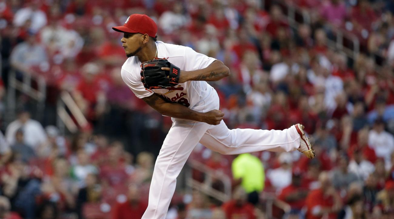 St. Louis Cardinals starting pitcher Carlos Martinez throws during the first inning of a baseball game against the Pittsburgh Pirates Friday, May 6, 2016, in St. Louis. (AP Photo/Jeff Roberson)