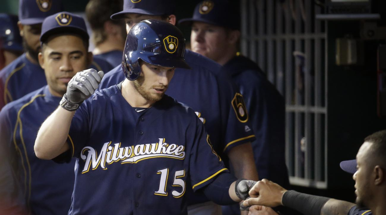 Milwaukee Brewers' Alex Presley (15) celebrates in the dugout after hitting a solo home run off Cincinnati Reds starting pitcher Tim Adleman in the fifth inning of a baseball game, Friday, May 6, 2016, in Cincinnati. (AP Photo/John Minchillo)