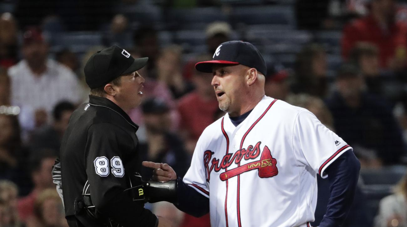 Atlanta Braves manager Fredi Gonzalez, right, argues with home plate umpire Cory Blaser after he ejected A.J. Pierzynski in the fifth inning of a baseball game against the Arizona Diamondbacks Friday, May 6, 2016, in Atlanta. (AP Photo/David Goldman)