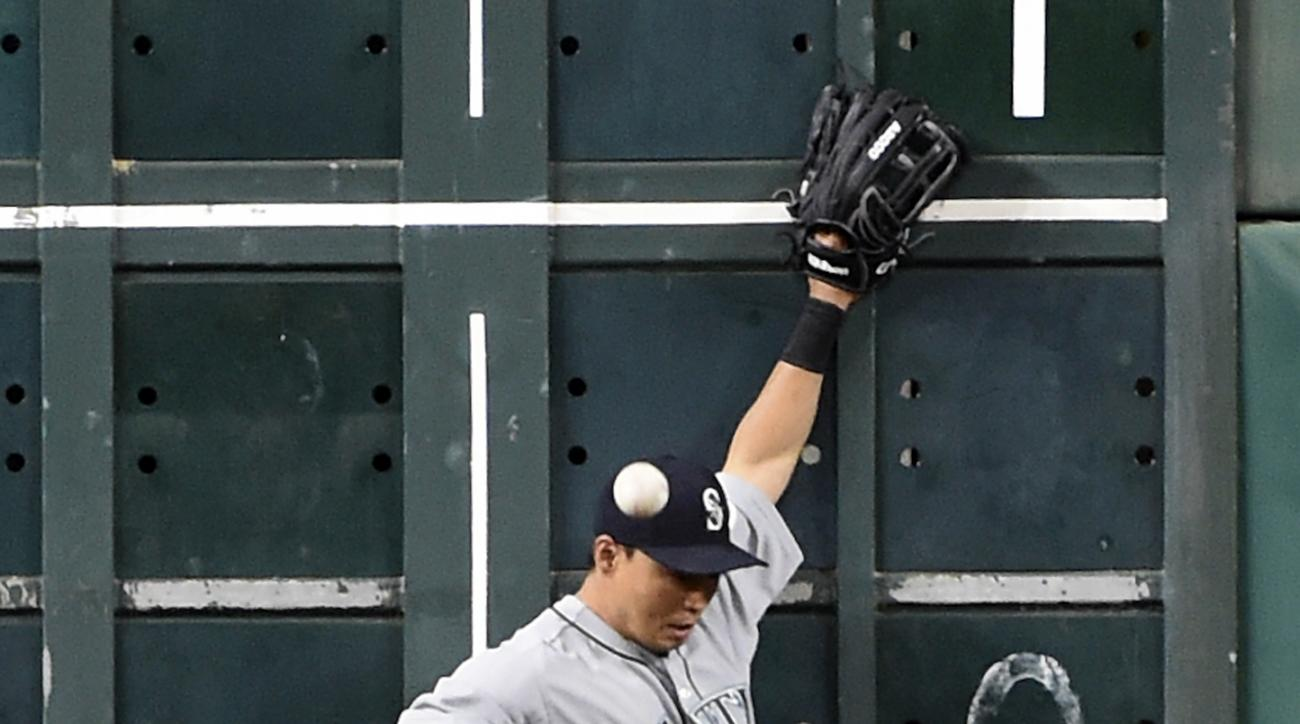 Seattle Mariners left fielder Norichika Aoki (8) can't make the catch at the wall of Houston Astros' Marwin Gonzalez' double in the sixth inning of a baseball game, Friday, May 6, 2016, in Houston. (AP Photo/Eric Christian Smith)