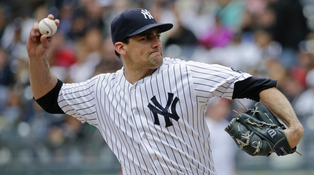 New York Yankees' Nathan Eovaldi delivers a pitch during the first inning of a baseball game against the Boston Red Sox Saturday, May 7, 2016, in New York. (AP Photo/Frank Franklin II)