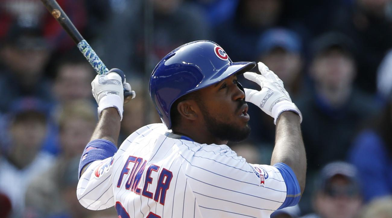 Chicago Cubs' Dexter Fowler hits an one-run triple against the Washington Nationals during the third inning of a baseball game Saturday, May 7, 2016, in Chicago. (AP Photo/Nam Y. Huh)