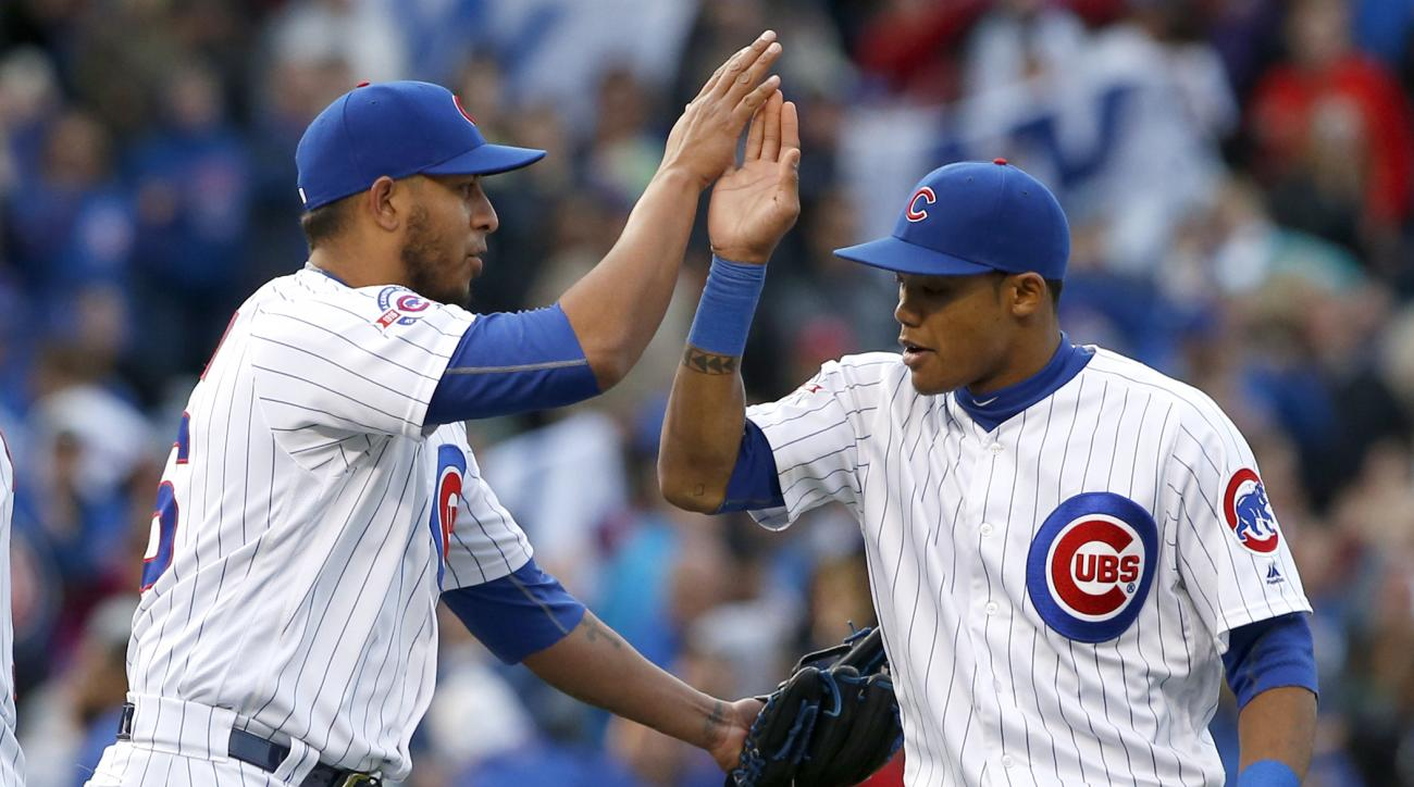 Chicago Cubs closer Hector Rondon, left, celebrates with Addison Russell after they defeated the Washington Nationals 8-5 in a baseball game Saturday, May 7, 2016, in Chicago. (AP Photo/Nam Y. Huh)