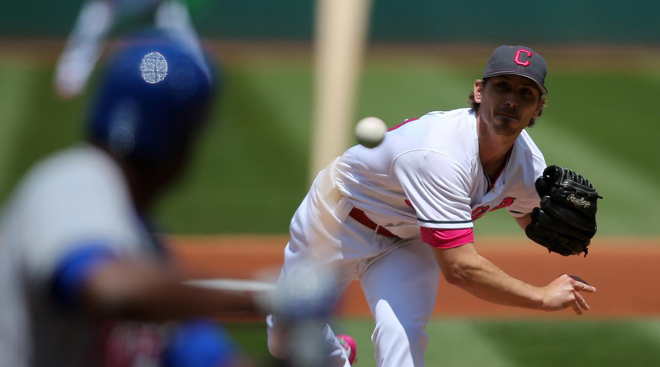 Cleveland Indians Josh Tomlin pitches during the first inning of a baseball game against the Kansas City Royals, Sunday, May 8, 2016, in Cleveland. (AP Photo/Aaron Josefczyk)