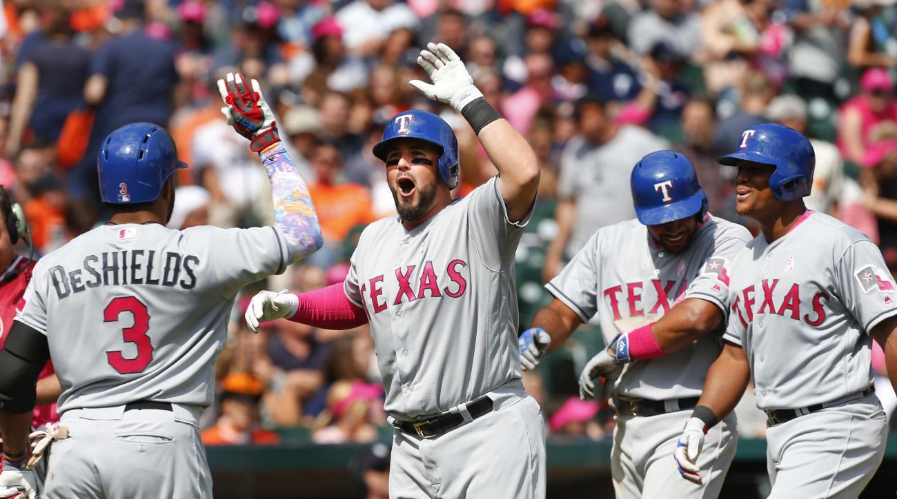 Texas Rangers' Bobby Wilson, second from left, celebrates his grand slam against the Detroit Tigers with Delino DeShields (3), Elvis Andrus and Adrian Beltre (29) in the eighth inning of a baseball game in Detroit, Sunday, May 8, 2016. (AP Photo/Paul Sanc