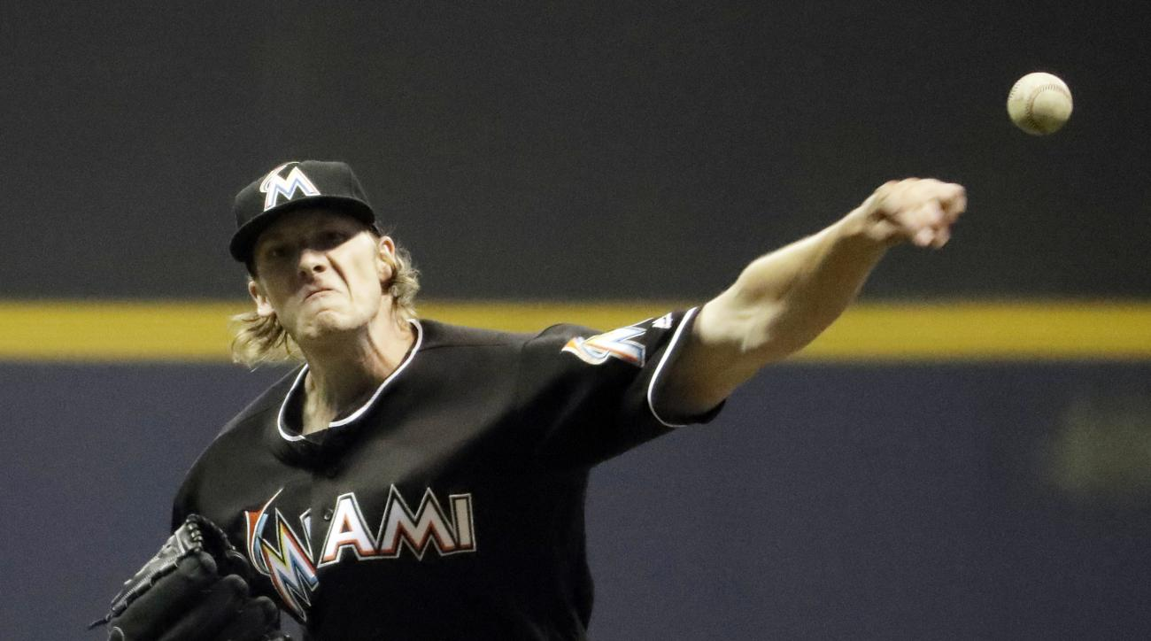 FILE - In this April 29, 2016, file photo, Miami Marlins starting pitcher Adam Conley throws during the seventh inning of a baseball game against the Milwaukee Brewers in Milwaukee. Conley allowed no hits in 7 2/3 shutout innings at Milwaukee on April 29