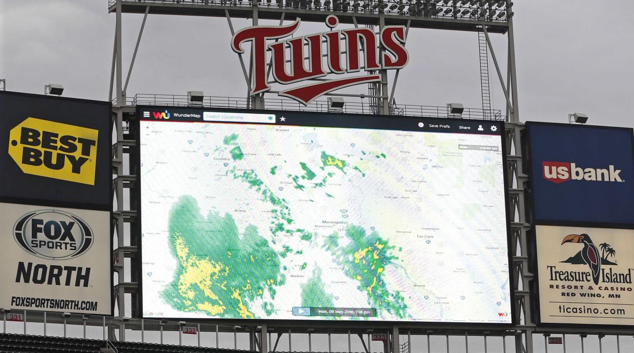 A radar view of a rain weather system approaching Minneapolis is shown on the the video screen after the baseball game between the Minnesota Twins and the Baltimore Orioles was postponed Monday, May 9, 2016, in Minneapolis. (AP Photo/Jim Mone)