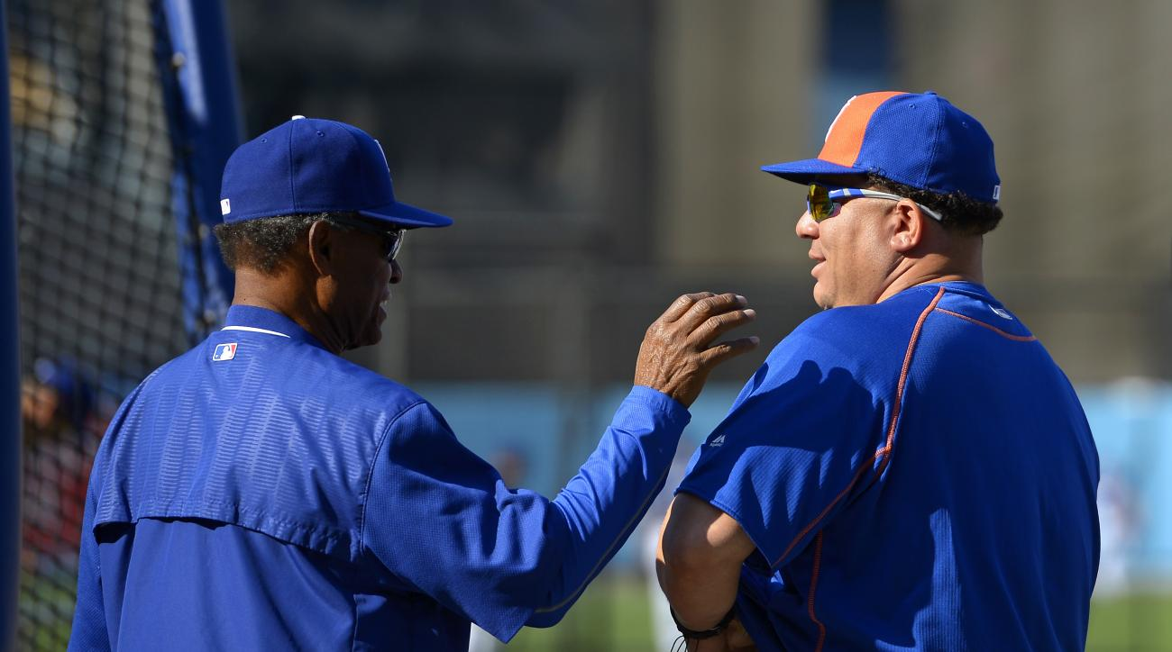 Los Angeles Dodgers coach Manny Mota, left, talks with New York Mets starting pitcher Bartolo Colon prior to a baseball game, Monday, May 9, 2016, in Los Angeles. (AP Photo/Mark J. Terrill)