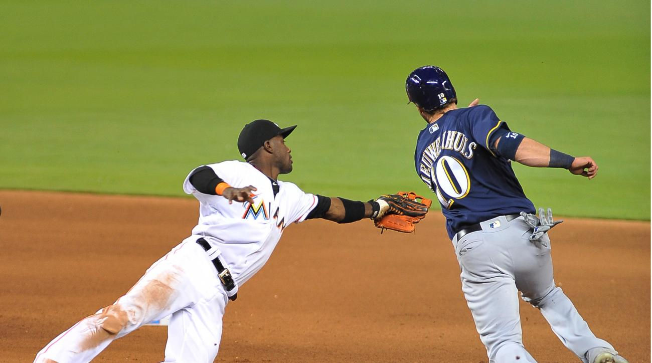 Miami Marlins shortstop Adeiny Hechavrria tags out Milwaukee Brewers Kirk Niewenhuis during the fifth inning of a baseball game, Monday, May 9, 2016, in Miami. (AP Photo/Gaston De Cardenas)