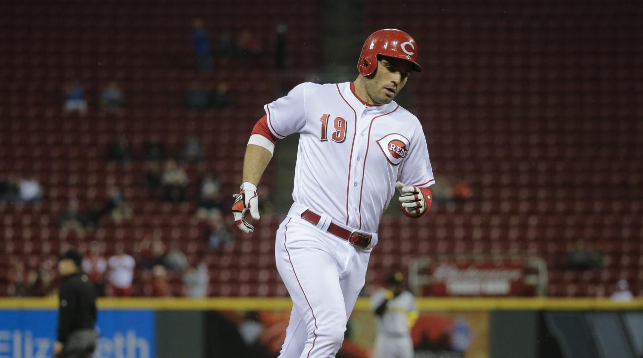 Cincinnati Reds' Joey Votto rounds the bases after hitting a solo home run off Pittsburgh Pirates starting pitcher Jonathon Niese in the sixth inning of a baseball game, Monday, May 9, 2016, in Cincinnati. (AP Photo/John Minchillo)