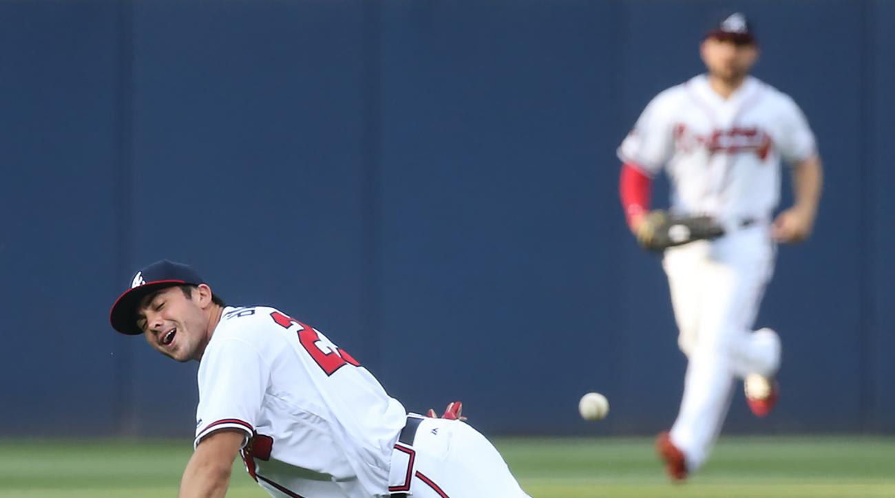 Atlanta Braves Chase dArnaud reacts to missing a single by Philadelphia Phillies Maikel Franco during the first inning of a baseball game on Tuesday, May 10, 2016, in Atlanta.   (Curtis Compton/Atlanta Journal-Constitution via AP)  MARIETTA DAILY OUT; GWI