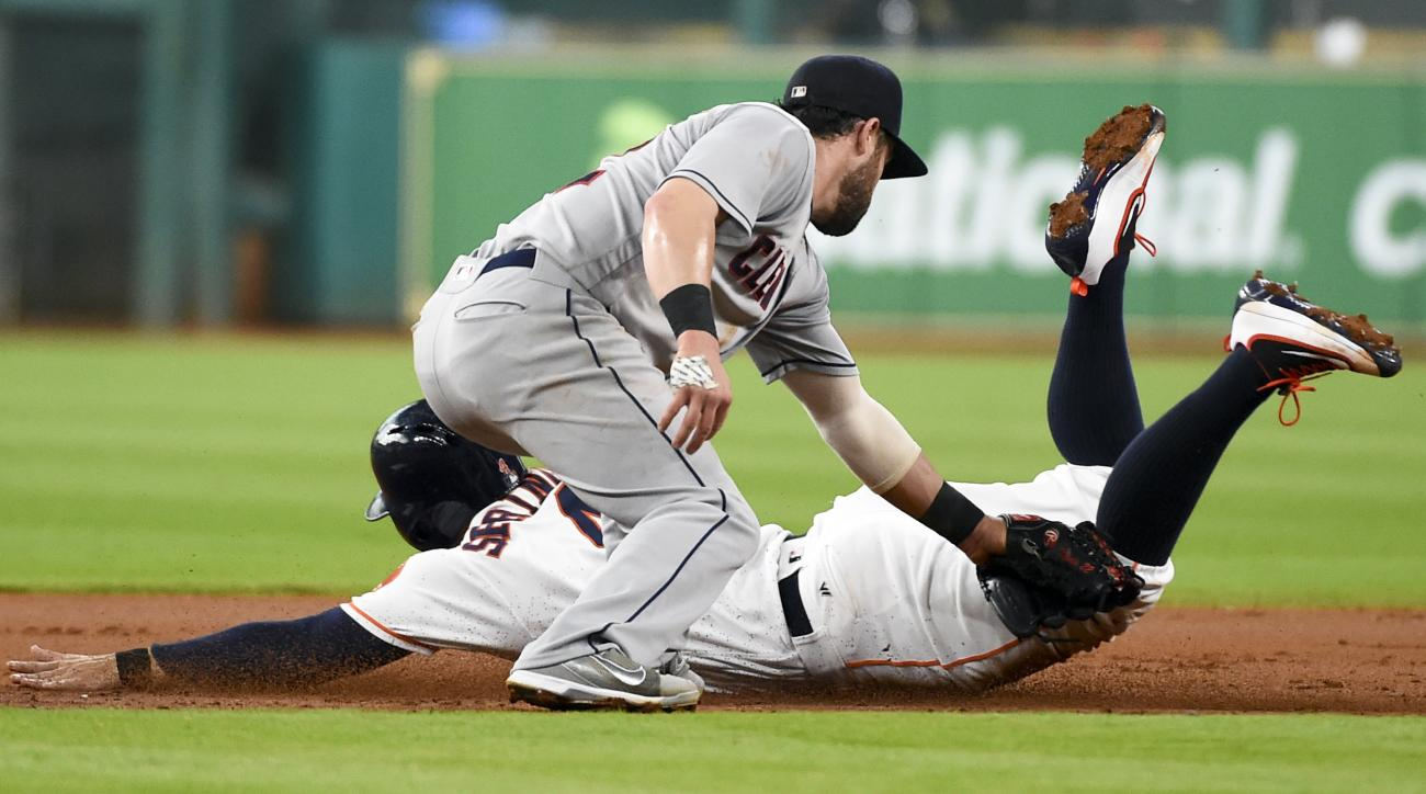Houston Astros' George Springer is tagged out by Cleveland Indians second baseman Jason Kipnis on a steal attempt during the first inning of a baseball game Tuesday, May 10, 2016, in Houston. (AP Photo/Eric Christian Smith)