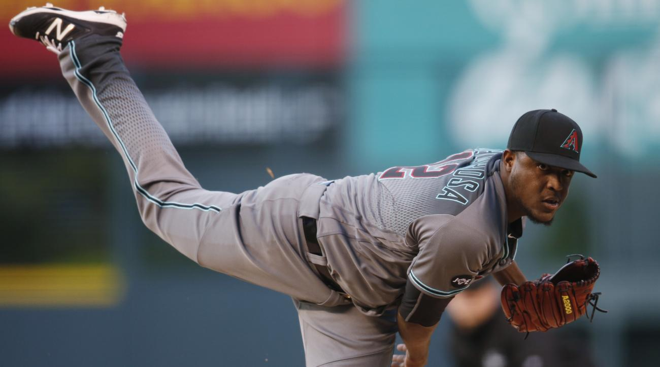 Arizona Diamondbacks starting pitcher Rubby De La Rosa delivers a pitch to Colorado Rockies' Carlos Gonzalez in the first inning of a baseball game Tuesday, May 10, 2016, in Denver. (AP Photo/David Zalubowski)