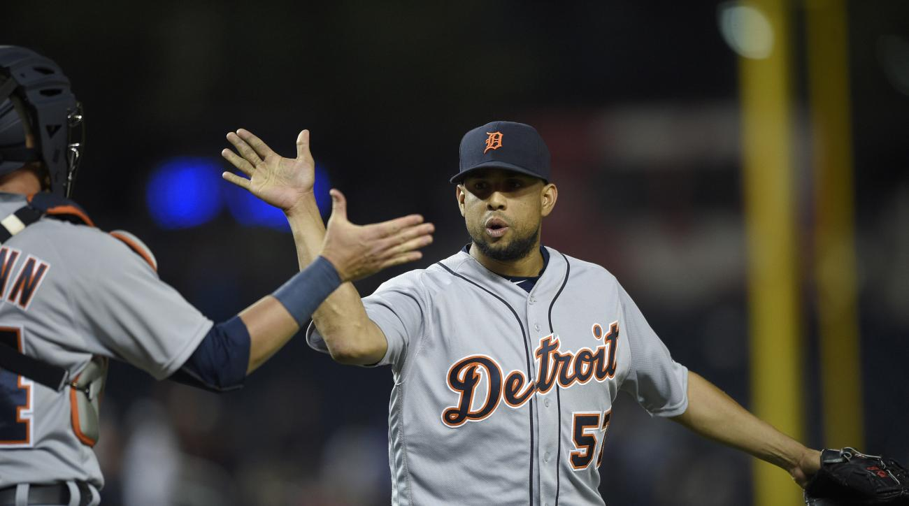 Detroit Tigers relief pitcher Francisco Rodriguez (57) celebrates their 5-4 win over the Washington Nationals with catcher James McCann, left, after an interleague baseball game, Tuesday, May 10, 2016, in Washington. (AP Photo/Nick Wass)