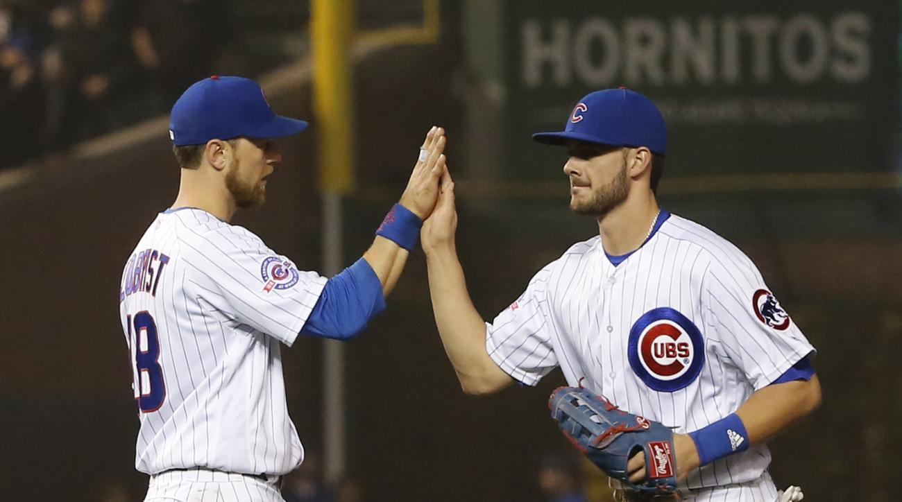 Chicago Cubs' Ben Zobrist (18) and Kris Bryant celebrate the Cubs' 8-7 win over the San Diego Padres in a baseball game Tuesday, May 10, 2016, in Chicago. (AP Photo/Charles Rex Arbogast)