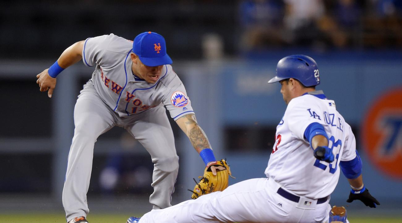 Los Angeles Dodgers' Adrian Gonzalez, right, is tagged out at second by New York Mets shortstop Asdrubal Cabrera as he tried to stretch a single into a double during the fifth inning of a baseball game Tuesday, May 10, 2016, in Los Angeles. (AP Photo/Mark