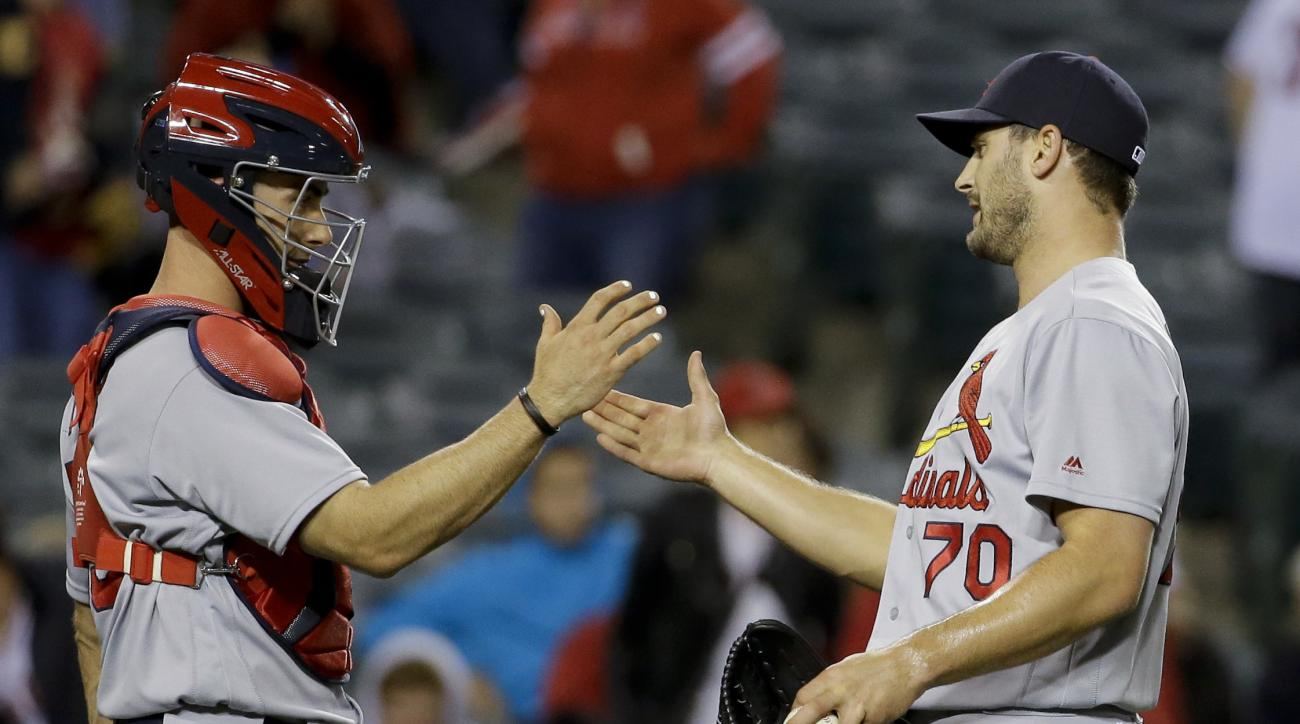 St. Louis Cardinals relief pitcher Tyler Lyons, right, and catcher Eric Fryer celebrate after the Cardinals' 8-1 win against the Los Angeles Angels during a baseball game in Anaheim, Calif., Tuesday, May 10, 2016. (AP Photo/Chris Carlson)