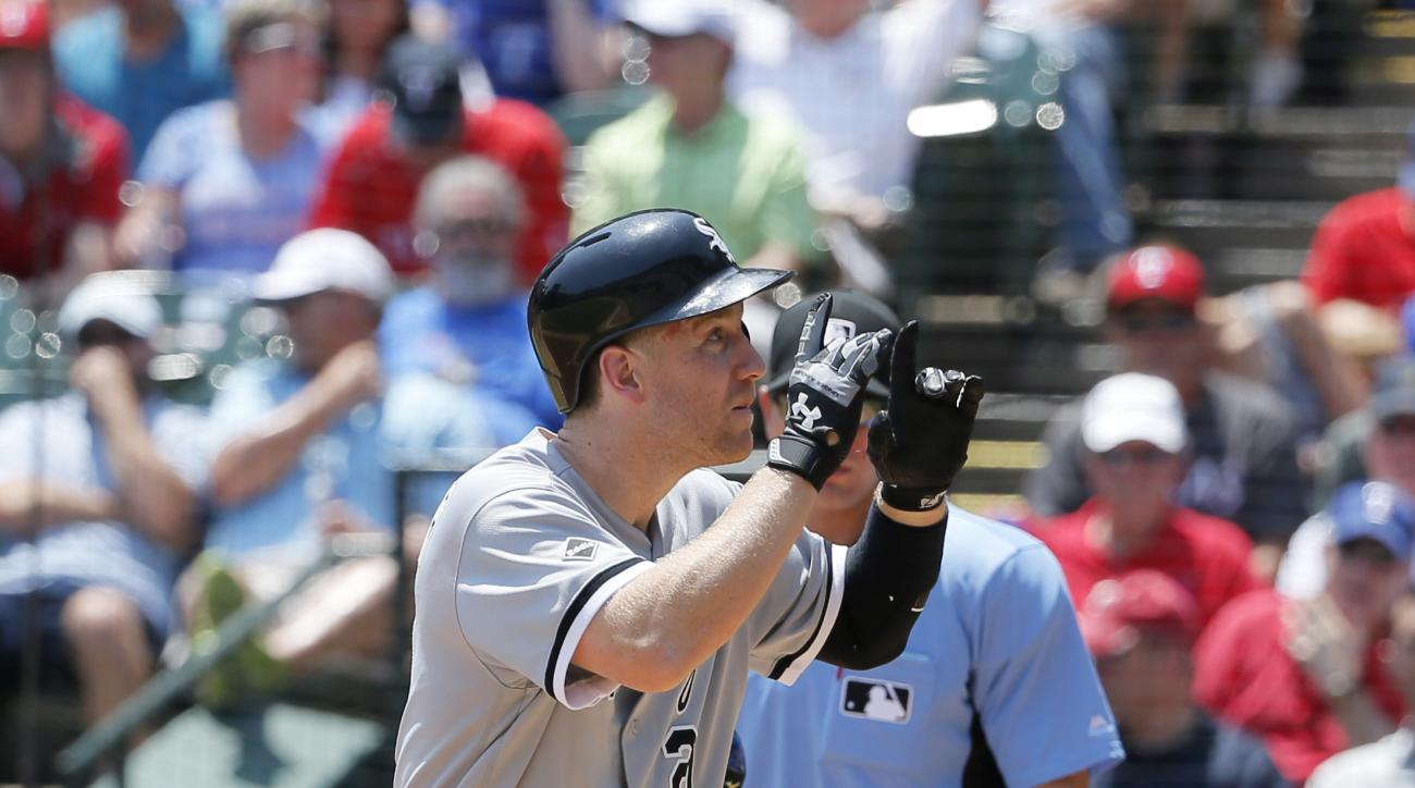 Chicago White Sox's Todd Frazier celebrates his solo home run after crossing the plate in front of Texas Rangers' Bobby Wilson in the fourth inning of a baseball game, Wednesday, May 11, 2016, in Arlington, Texas. (AP Photo/Tony Gutierrez)