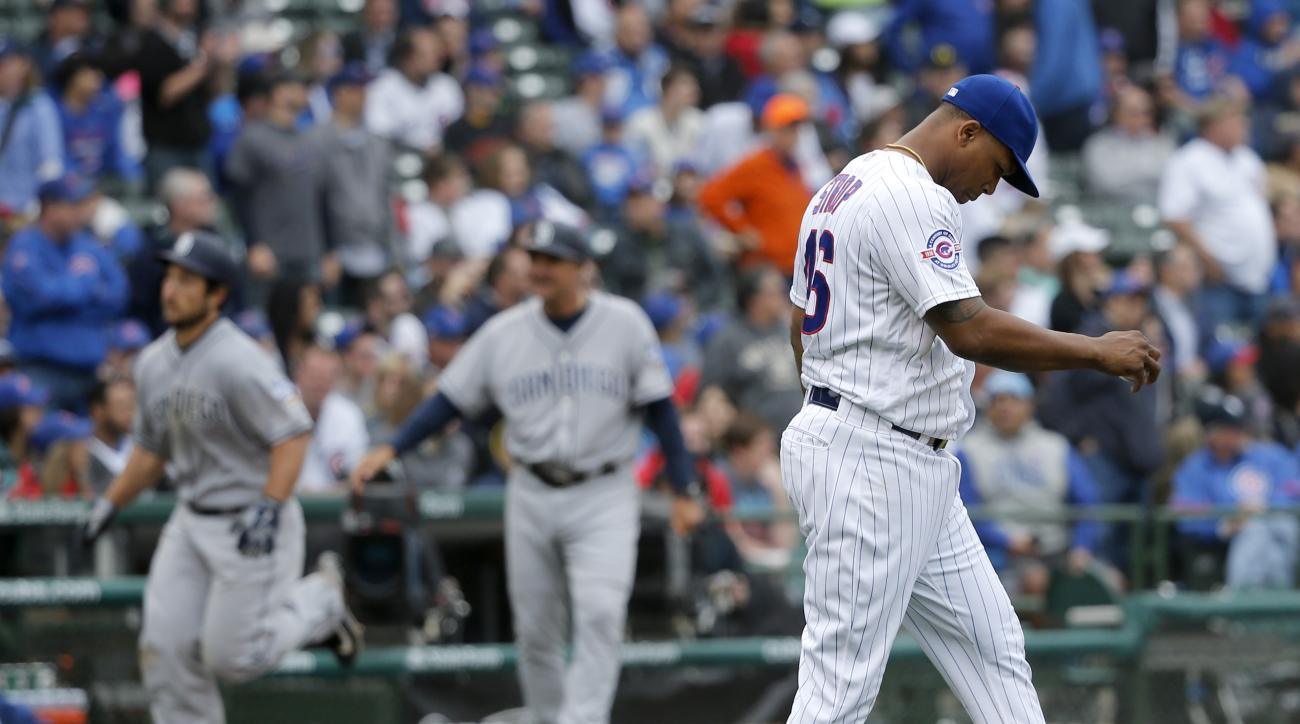Chicago Cubs relief pitcher Pedro Strop, right, returns to the mound after giving up a three-run home run to San Diego Padres' Brett Wallace, left, during the seventh inning of a baseball game Wednesday, May 11, 2016, in Chicago. Wil Myers and Matt Kemp a