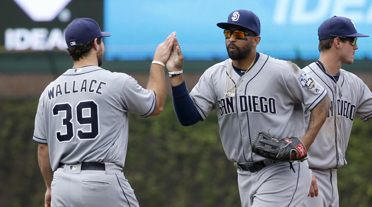 San Diego Padres' Brett Wallace (39) and Matt Kemp celebrate the Padres' 7-4 win over the Chicago Cubs after a baseball game Wednesday, May 11, 2016, in Chicago. (AP Photo/Charles Rex Arbogast)