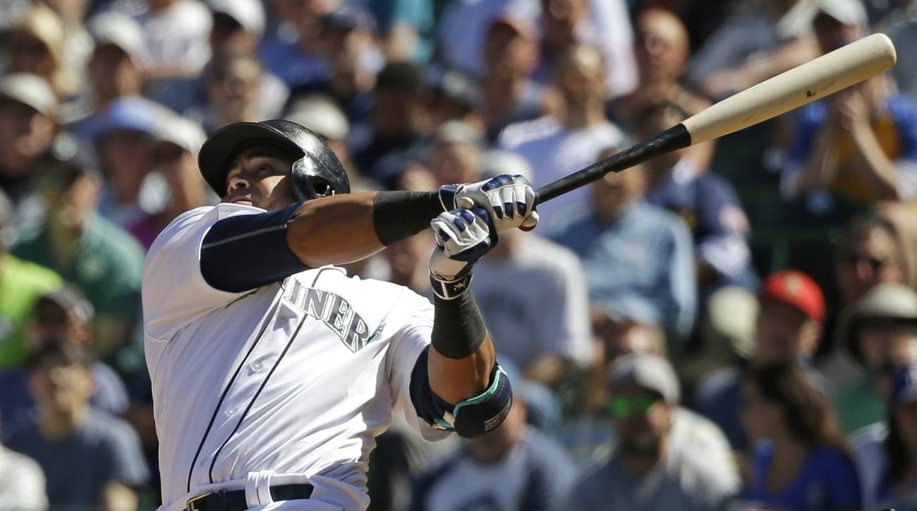 Seattle Mariners' Nelson Cruz watches his sacrifice fly that scored Robinson Cano in the seventh inning of a baseball game against the Tampa Bay Rays, Wednesday, May 11, 2016, in Seattle. (AP Photo/Ted S. Warren)