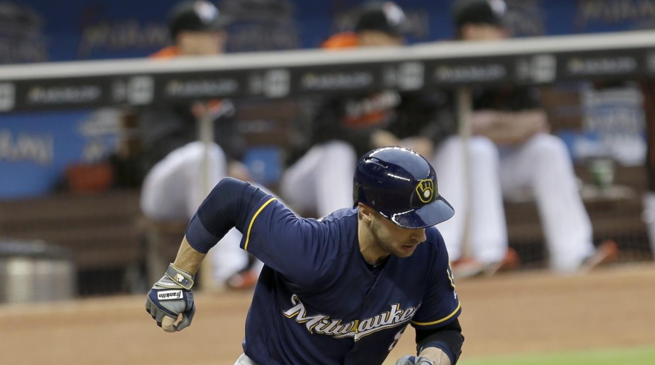 Milwaukee Brewers' Ryan Braun heads to first base on a base hit against the Miami Marlins during the first inning of a baseball game, Wednesday, May 11, 2016, in Miami. (AP Photo/Alan Diaz)