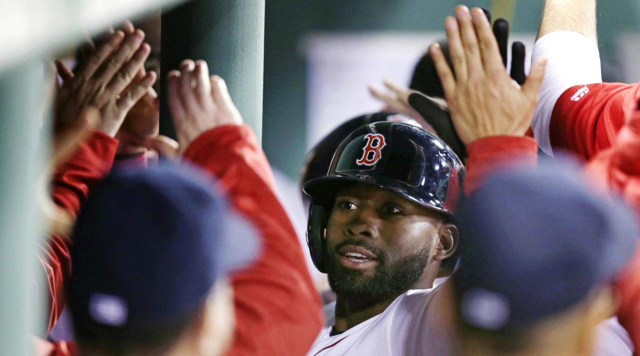 Boston Red Sox's Jackie Bradley Jr. is congratulated by teammates in the dugout after his two run home run in the eighth inning of a baseball game against the Oakland Athletics at Fenway Park in Boston, Wednesday, May 11, 2016. Bradley had two home runs a