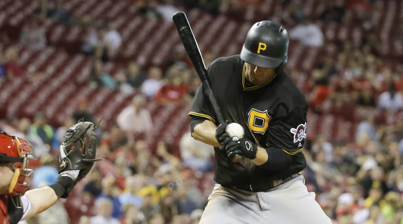 Pittsburgh Pirates' David Freese is hit by a pitch from Cincinnati Reds reliever Ross Ohlendorf during the ninth inning of a baseball game Wednesday, May 11, 2016, in Cincinnati. The Pirates won 5-4. (AP Photo/John Minchillo)