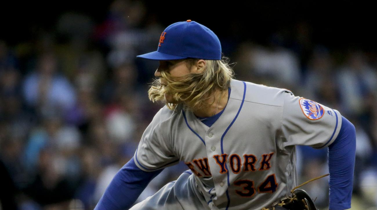 New York Mets starting pitcher Noah Syndergaard throws against the Los Angeles Dodgers during the first inning of a baseball game in Los Angeles, Wednesday, May 11, 2016. (AP Photo/Chris Carlson)