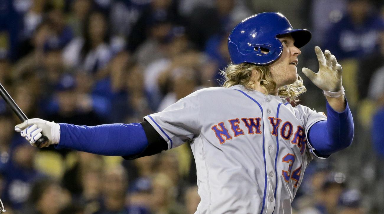 Noah Syndergaard watches his three-run home run during the fifth inning of a baseball game against the Los Angeles Dodgers in Los Angeles, Wednesday, May 11, 2016. (AP Photo/Chris Carlson)