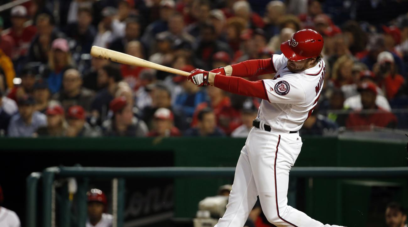 In this photo taken May 11, 2016, Washington Nationals second baseman Daniel Murphy (20) bats during an interleague baseball game against the Detroit Tigers at Nationals Park in Washington.  If things were quiet around the club on Thursday, May 12, 2016,