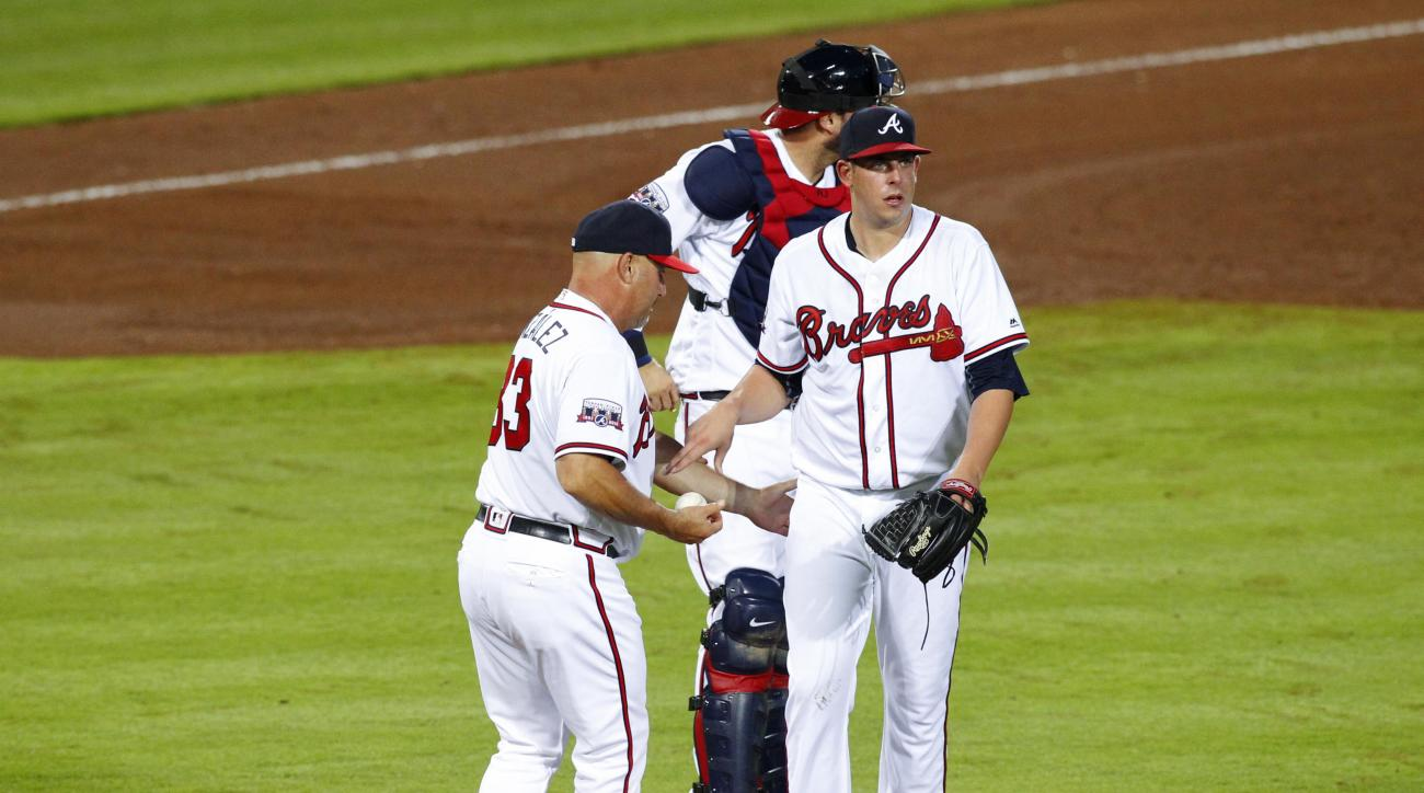 Atlanta Braves manager Fredi Gonzalez (33) removes pitcher Aaron Blair (36) from the game as A.J. Pierzynski looks on in the fourth inning of a baseball game against the Philadelphia Phillies, Thursday, May 12, 2016, in Atlanta. (AP Photo/Brett Davis)