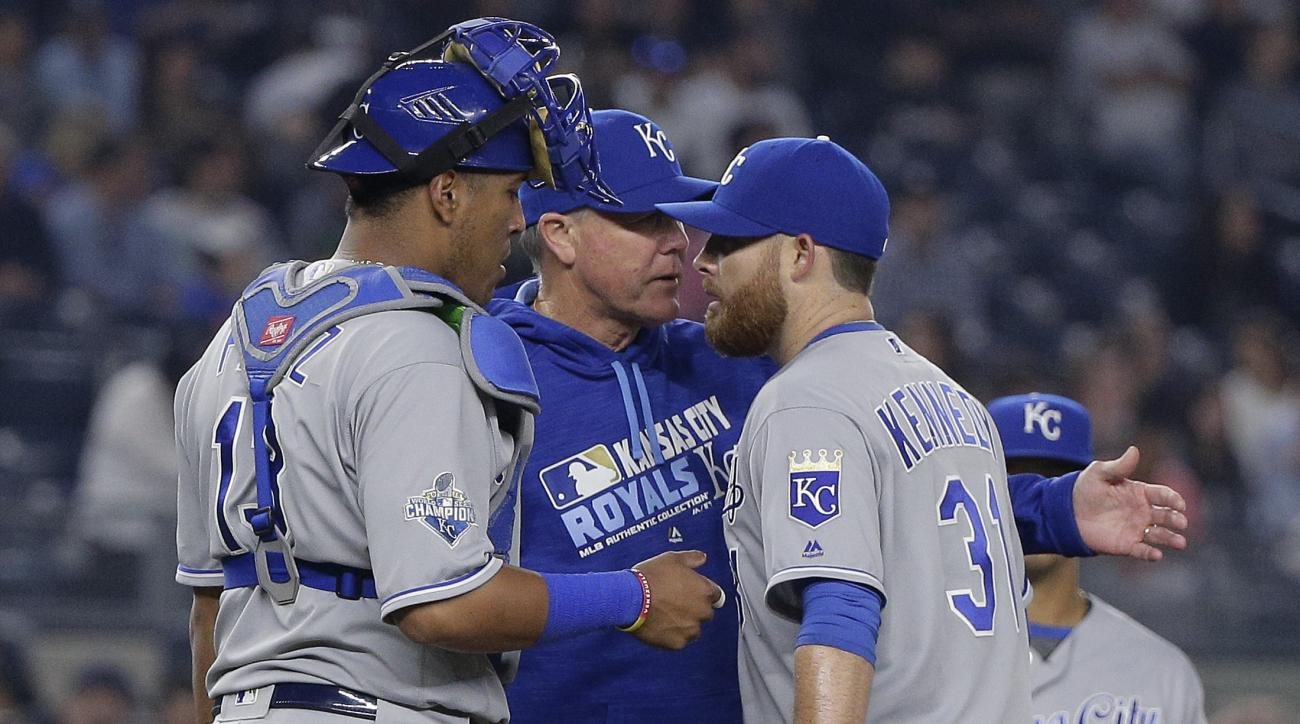 Kansas City Royals manager Ned Yost, center, removes pitcher Ian Kennedy (31) as catcher Salvador Perez (13) listens during the seventh inning of a baseball game against the New York Yankees, Thursday, May 12, 2016, in, New York. (AP Photo/Julie Jacobson)