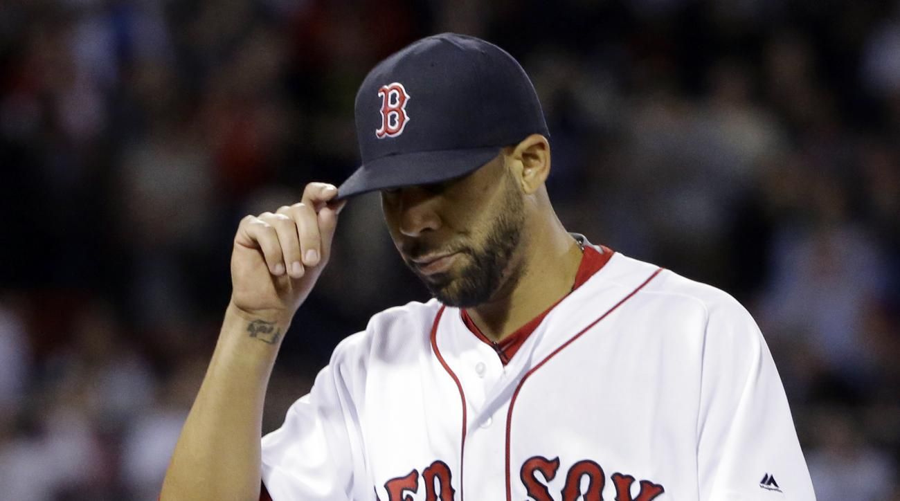 Boston Red Sox starting pitcher David Price tips his cap to cheering fans as he is taken out during the seventh inning of a baseball game against the Houston Astros at Fenway Park, Thursday, May 12, 2016, in Boston. (AP Photo/Elise Amendola)