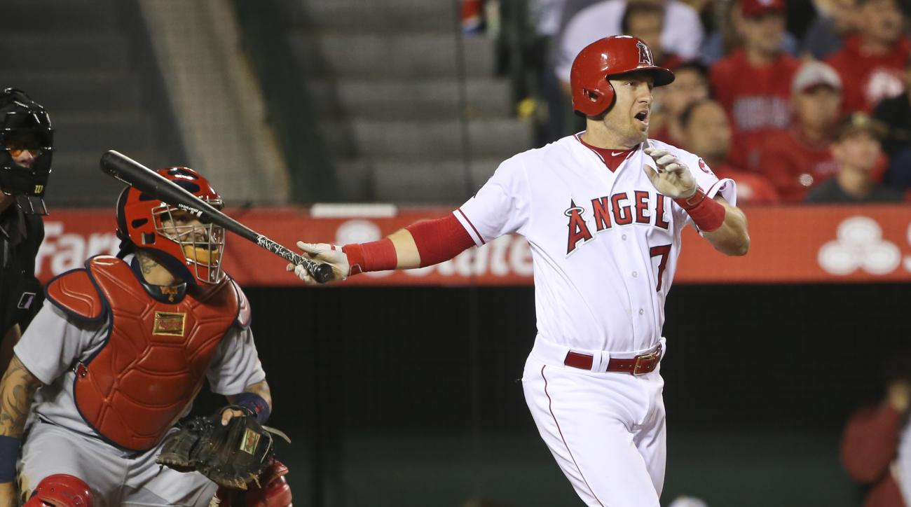 Los Angeles Angels' Cliff Pennington brings in a run with a base hit during the fourth inning against the St. Louis Cardinals in a baseball game Thursday, May 12, 2016, in Anaheim, Calif. (AP Photo/Lenny Ignelzi)