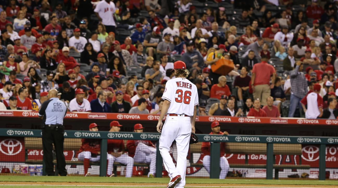 Los Angeles Angels starting pitcher Jered Weaver walks off the mound after surrendering eight runs in four innings against the St. Louis Cardinals in a baseball game Thursday, May 12, 2016, in Anaheim, Calif. (AP Photo/Lenny Ignelzi)