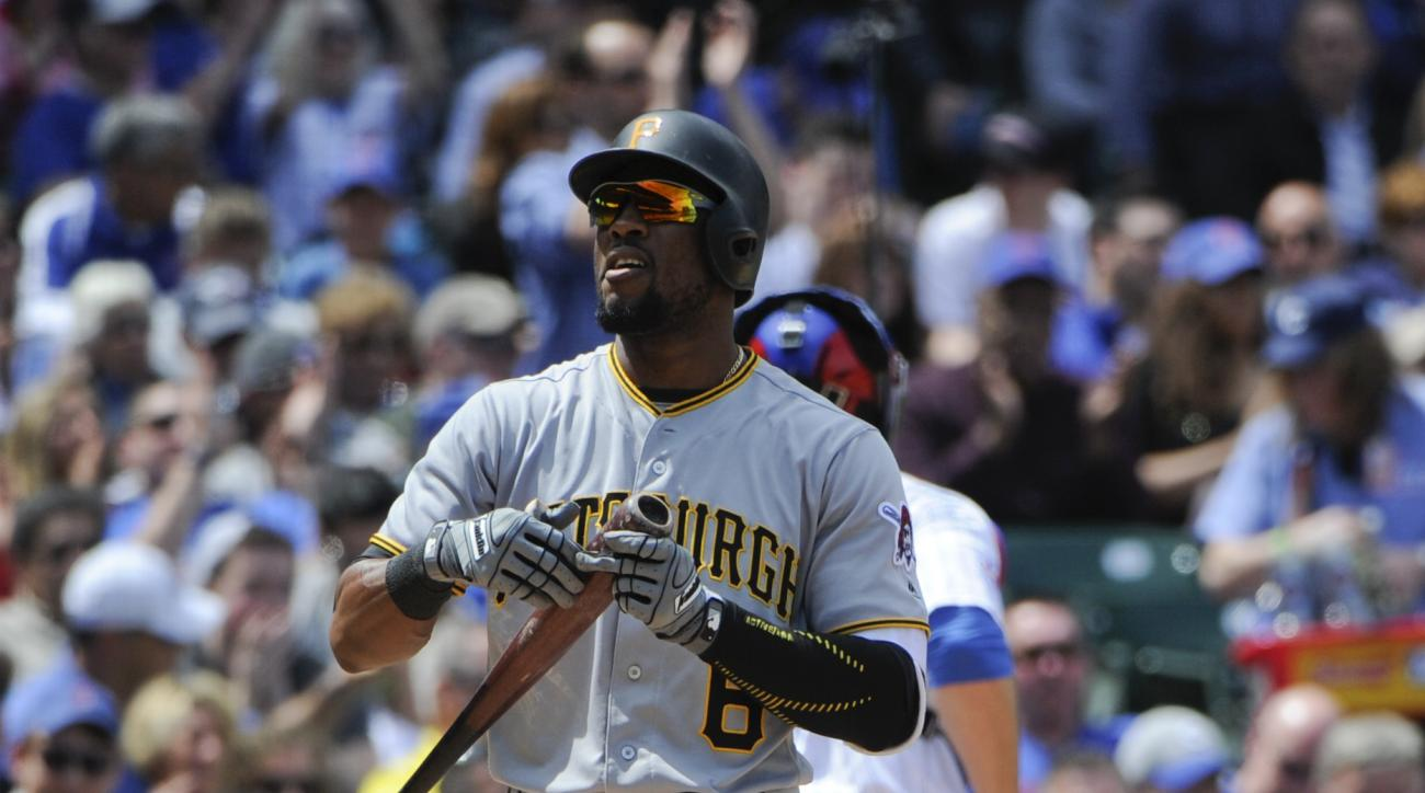 Pittsburgh Pirates Starling Marte reacts after striking out leaving two men on base in the third inning of a baseball game against the Chicago Cubs on Friday, May 13, 2016, in Chicago. (AP Photo/Matt Marton)