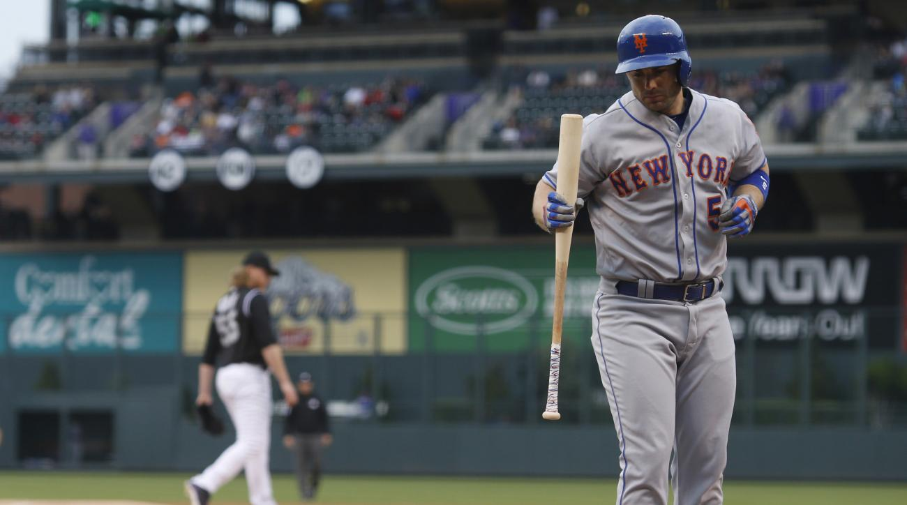 New York Mets' David Wright, front, reacts after striking out against Colorado Rockies starting pitcher Jon Gray in the first inning of a baseball game Friday, May 13, 2016, in Denver. (AP Photo/David Zalubowski)