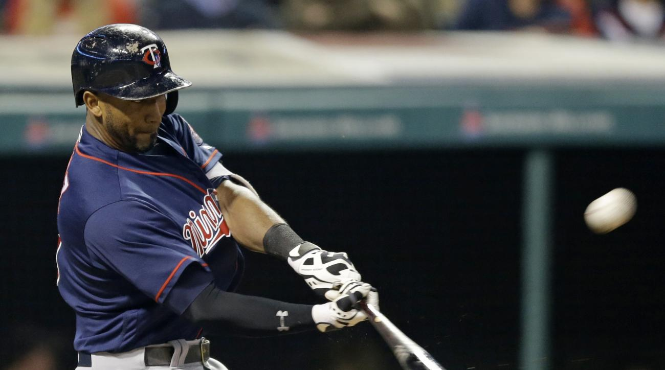 Minnesota Twins' Eduardo Nunez hits a solo home run off Cleveland Indians relief pitcher Bryan Shaw during the eighth inning of a baseball game Friday, May 13, 2016, in Cleveland. (AP Photo/Tony Dejak)