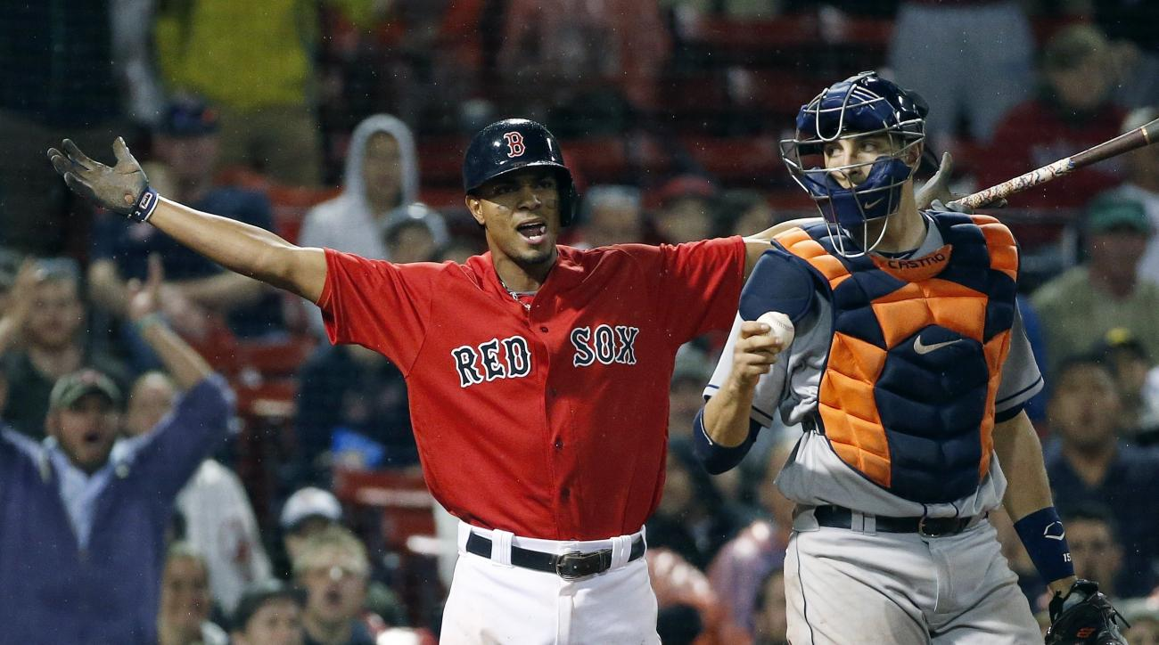 Boston Red Sox's Xander Bogaerts, left, reacts beside Houston Astros' Jason Castro after he struck out swinging during the ninth inning of a baseball game in Boston, Friday, May 13, 2016. The Astros won 7-6. (AP Photo/Michael Dwyer)