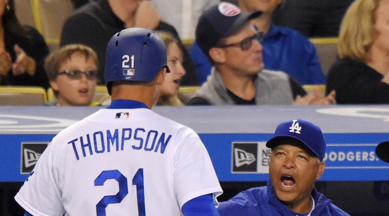 Los Angeles Dodgers manager Dave Roberts, right, congratulates Trayce Thompson after Thompson scored on a single by Howie Kendrick during the second inning of a baseball game against the St. Louis Cardinals, Friday, May 13, 2016, in Los Angeles. (AP Photo