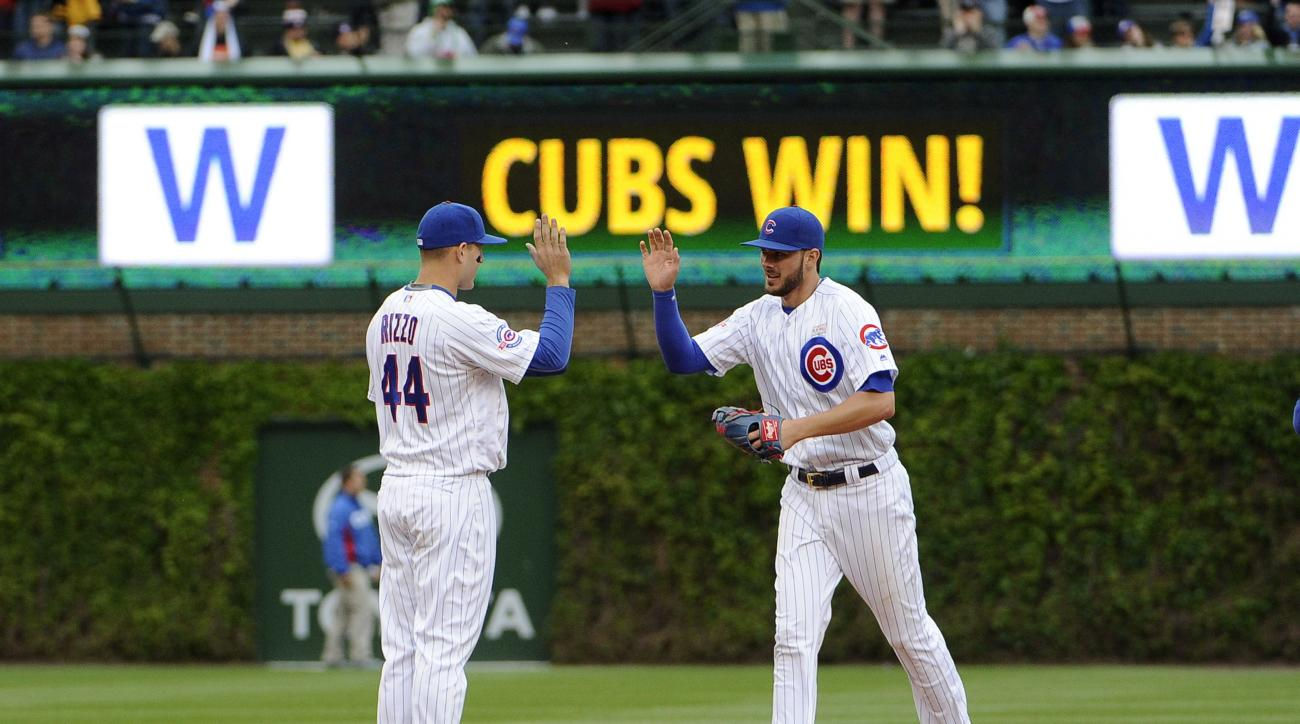 Chicago Cubs first baseman Anthony Rizzo (44) and Kris Bryant (17) celebrate their win over the Pittsburgh Pirates in a baseball game, Saturday, May 14, 2016, in Chicago. (AP Photo/David Banks)