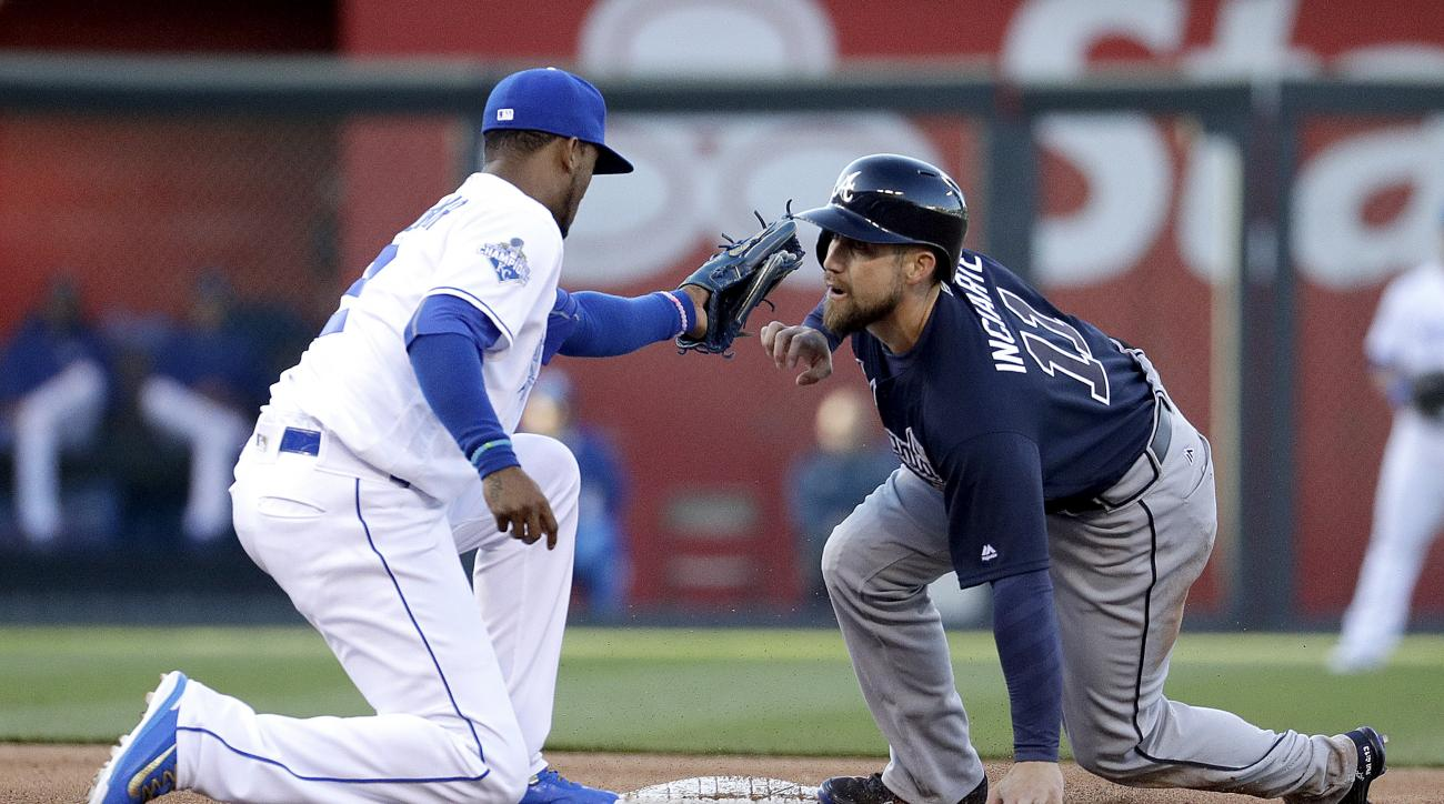 Atlanta Braves' Ender Inciarte (11) is tagged out by Kansas City Royals shortstop Alcides Escobar as he got caught trying to steal second base during the fifth inning of a baseball game Saturday, May 14, 2016, in Kansas City, Mo. (AP Photo/Charlie Riedel)