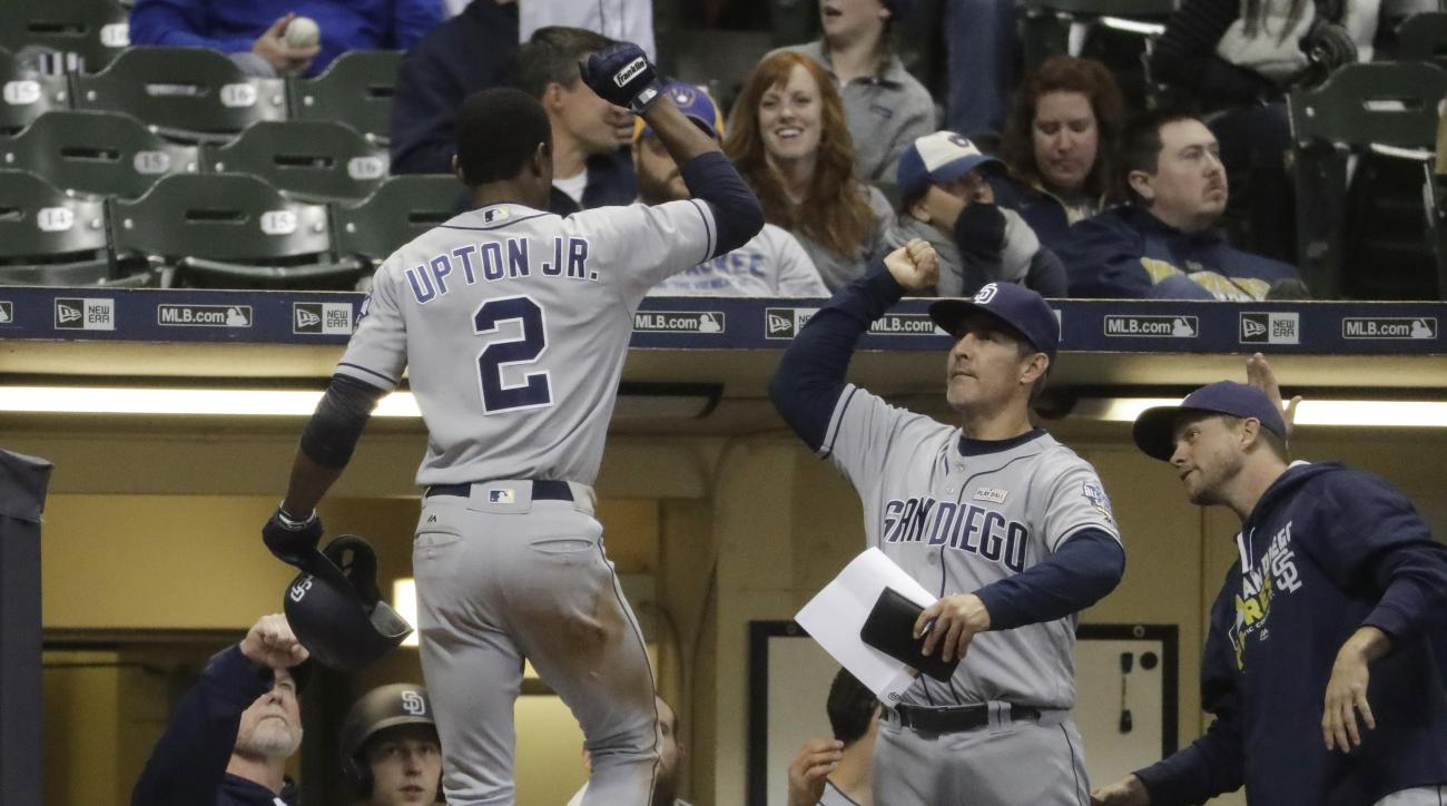 San Diego Padres' Melvin Upton Jr. is congratulated after hitting a home run during the 12th inning of a baseball game against the Milwaukee Brewers Saturday, May 14, 2016, in Milwaukee. (AP Photo/Morry Gash)