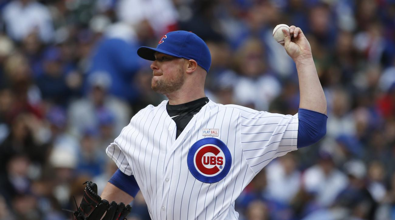 Chicago Cubs starter Jon Lester throws against the Pittsburgh Pirates during the first inning of a baseball game, Sunday, May 15, 2016, in Chicago. (AP Photo/Nam Y. Huh)