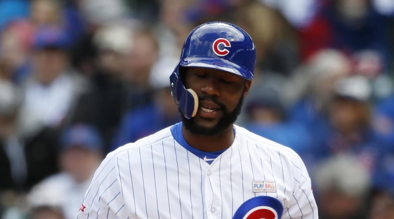 Chicago Cubs' Jason Heyward reacts after striking out on a foul tip during the first inning of a baseball game against the Pittsburgh Piratesm Sunday, May 15, 2016, in Chicago. (AP Photo/Nam Y. Huh)