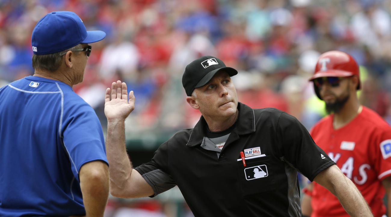 Home plate umpire Dan Iassogna, right, ejects Toronto Blue Jays manager John Gibbons (5) during the third inning of a baseball game against the Texas Rangers in Arlington, Texas, Sunday, May 15, 2016. (AP Photo/LM Otero)