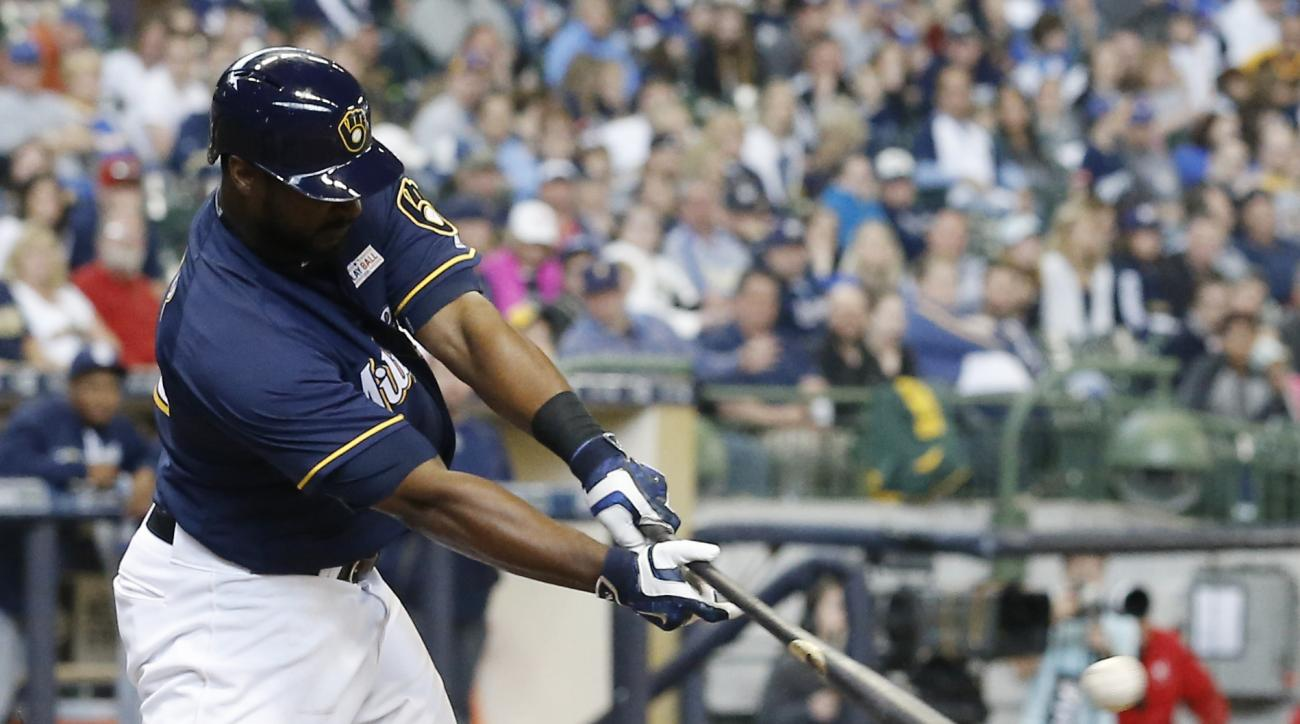 Milwaukee Brewers' Chris Carter hits an RBI double during the seventh inning of a baseball game against the San Diego Padres Sunday, May 15, 2016, in Milwaukee. (AP Photo/Morry Gash)